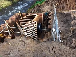web Pipes river bank